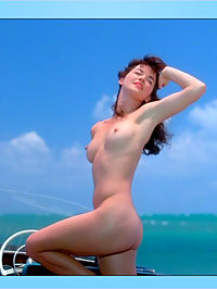 Gretchen Mol poses on nude a boat, exposing creamy tits and ample ass.