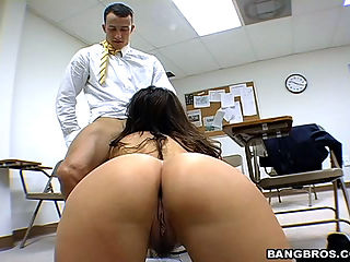 This is the kinda classroom where the teacher is hands on. Stroking cock and giving handjobs is her specialty. Not to mention getting a hard dick laying on her back.