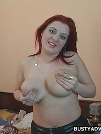 Busty redhead bends over for cock