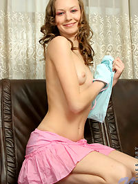 Curly brunette teen strips off really great in just about any position on couch