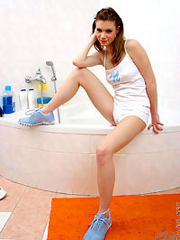 Sweet teen in a tub lathers lotion all over her soft skin and then washes it off oh so carefully