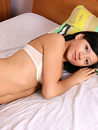 Pretty Nubile Anushka gets naked on her bed for a sweet finger play her with her hot pussy