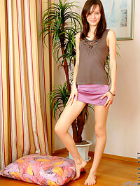 Lovely Nubile teen Arianna reveals her tight slender frame and her hairy pussy