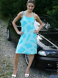 this is one hell of a cute teen just look at her and the beautiful bmw she is sitting on flashing