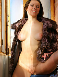 Hottie helen has nice tits hanging out of her furcoat as she stands in the sunlight