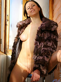 Big tits hottie helen wears only a fur coat as she smiles and poses