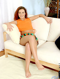 Redhead teen on couch unleashing awesome sexy body
