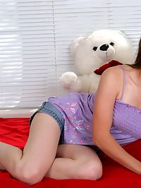 Cute jules sits on her bed and flops her a cup tits out and smiles her hair down and she is set