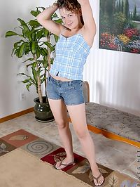 Curly karma bare breasted posing with legs spread apart