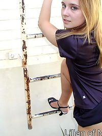 Upskirt shot of blonde teen climbing ladder