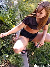 Amateur teen plays with pussy outside