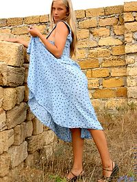 Ljuba stands outside in a pretty sundress slowly taking it off she is stunning