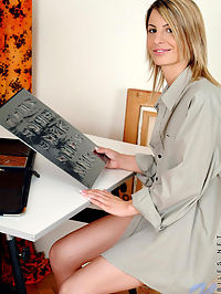 Hot nubile mandy is in her workshirt doing some art shit but she get nice and naked for us