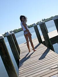 Tempting brunette teen sun bathes in the nude