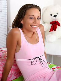 Tiny boobies teen tresseme sits in pink and shows all shes got off to the camera