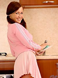 Pony tailed redhead teen opens her pink blouse for a warm welcome