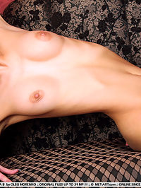 IRINA BSERENE by OLEG MORENKO : Irina has dark hair, medium breasts , glowing blue eyes and big round nipples, watch as she gets nude.