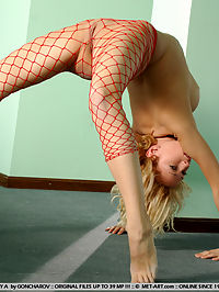 FEY ATRAINING by GONCHAROV : Flexible dancer in red fishnet stockings shows her talent and everything you want to see too.