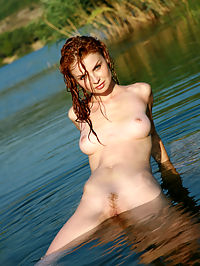 NATALIA APIKASSIA by VORONIN : Cat like smile and all women like body for this nature shoot.
