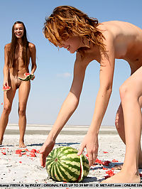ITNA A and FREYA AANGURIA by RYLSKY : 2 Hot little models play some odd naked games out on the beach.