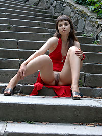 VIKI BPRESENTING VIKI by GONCHAROV : Fair skinned brunette gets frisky in a red dress and heels.