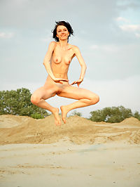 ALISA DANCEUSE by SKOKOV : Brunette displays her flexibility and long legs in the sand by the beach.