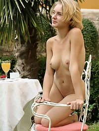 Summer Breakfast : Talk about a breath of fresh air, a flash of warm summer, a breeze of delightful bliss. Thats Magda. So clear and clean, shes a blonde lovely model with a cute face and a great body, and shes here in this classic FEMJOY set enjoying an outdoor breakfast totally in the nude.