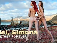 Together Forever : Two purely sexy girls - Ariel with fiery red hair and Simona with streaming brunette hair, prance around on the side of a river. They are both completely naked and enjoying the wind blowing their hair all over and their freedom of this beautiful, warm, dramatic day.. You can almost feel the wind blowing, the hair lashing, and the warmth of the sun setting. This video will make it so you can imagine yourself in this situation, perfectly.