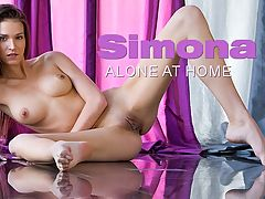 Alone At Home : Purple drapes are blowing in the wind, and lovely Simona is wearing nothing but a litght blude mens shirt that quickly comes off. She is completely naked, moving around on the ground, and feeling herself in the seductive way that Simona is so good at. Sunlight shines on her face, body, flower, giving her even more dimensions as she flows through the windy room.