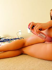 Haley splits her pussy with a pink dildo