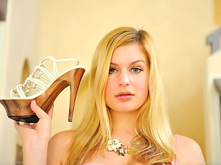 Danielle plays with her shoe