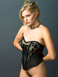 Liz busts out of her black bustier.