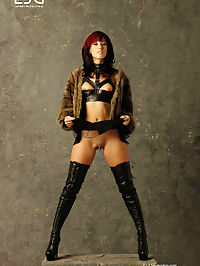 Bondage Babe in Leather and Heels Strips Down