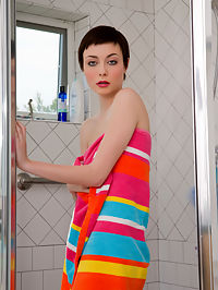 Foxy petite brunette Zoe Voss on the showers takes off her towel showing her naked sexy body