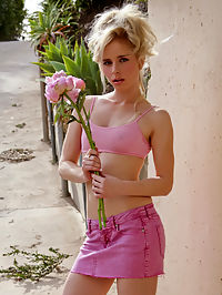 Charming Kara Duhe in her sexy, pink outfit rubbing her sweet, small nipples outdoors