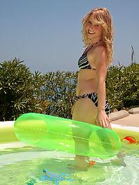 Sweet Kara in the pool strips off her sexy bikini flashing her goodies