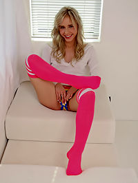 Flirty Kara wearing her sexy, pink socks spreading her legs and toying her pussy
