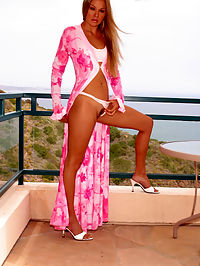 Dazzling Phoenix on the terrace teasing in her pink robe slides off her wet panties revealing her hairy pussy