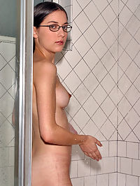 Larissa naked in the shower showing her shaved and creamed pussy