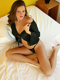 Sizzling hot Sandra Shine in her seductive, black lingerie bent over on her bed stuffing a huge toy into her little, pink hole