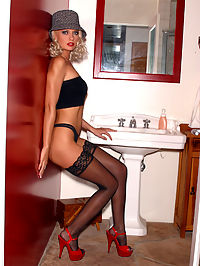 Glamorous Kelli sits on the sink in her black lingerie spreading her tight ass