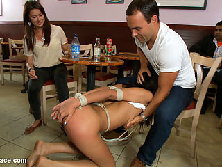Degraded in the Sandwich Shop : Lyla Storm is tied tight with her elbows together and lead into a sandwich shop on a crotch rope. All the customers get into the show and spank and fondle Lyla within seconds of her entrance. She is humiliated by getting fucked with her head in the trash can, food smeared all over her body, and being made to suck and fuck the guy behind the counter.