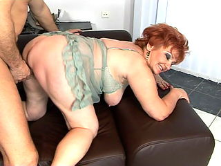 Filthy grandma enjoying a hard cock in her holes