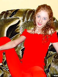 Young redheaded cutie takes off her red dress