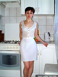 Young brunette housemaid playing pornstar in the kitchen