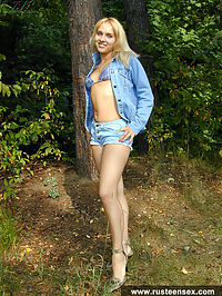 Russian teen blonde getting naked in public park
