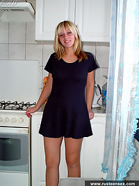 Young blond housemaid shows what Russian girls do at kitchen