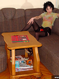 Little Goth teen girl in red lingerie and black tights