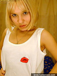 Blonde teen girl masturbates with a dildo