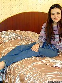 Pretty virgin playing with long orange dildo